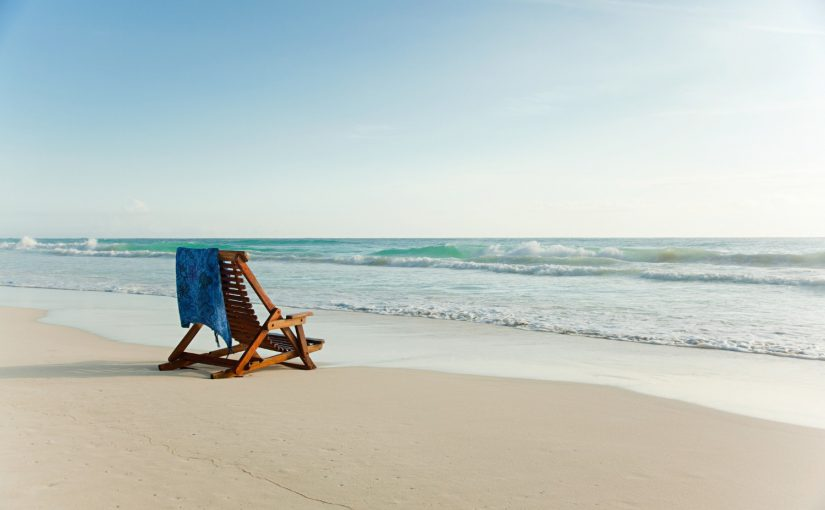 Best Beaches in North Carolina | View of lone chair facing the ocean